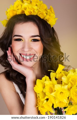 Happy smiling girl with yellow flowers - stock photo