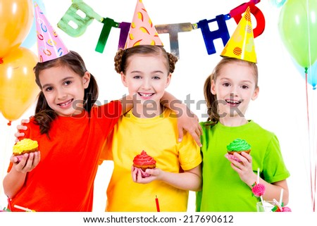 Happy smiling  girls holding colorful cakes - isolated on a white background. - stock photo