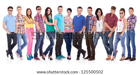 Happy smiling  group of friends standing together in a row isolated on white background
