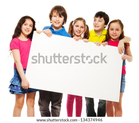 Happy smiling group of kids, friends, boys and girls, showing blank placard board to write it on your own text isolated on white background - stock photo