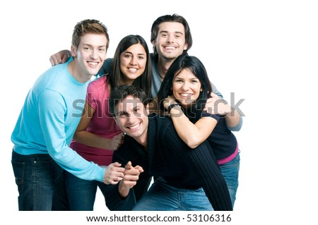 Happy smiling group of young friends standing and embracing together isolated on white background with copy space - stock photo