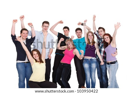 Happy smiling group of young friends standing and embracing together on white background - stock photo