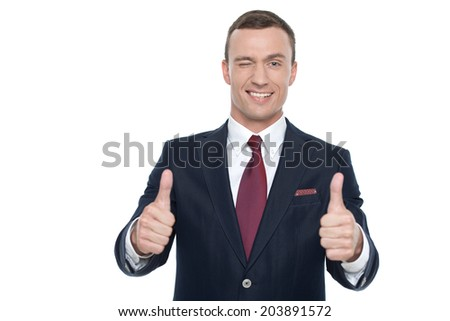 Happy smiling guy showing thumbs up hand sign, isolated - stock photo