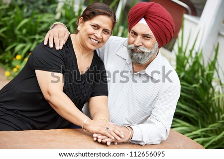 Happy Smiling indian sikh adult people couple outdoors