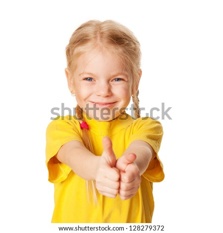 Happy smiling little girl with pigtails showing a thumbs up sign or OK symbol. A child wearing a yellow T-shirt. Ready for your text or logo. Isolated on white background - stock photo