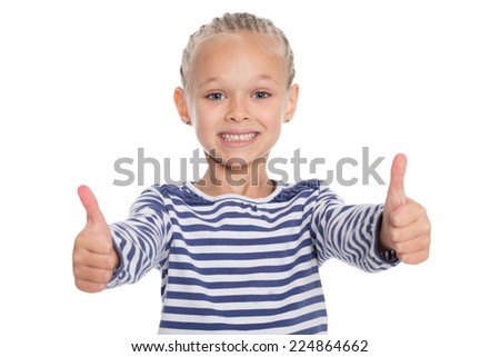Happy smiling little girl with thumbs up gesture, isolated on white background. Girl is six years old. - stock photo