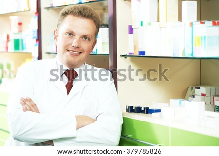 happy smiling medical pharmacist or pharmacy worker - stock photo