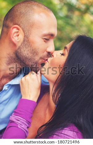 Happy smiling middle-aged couple kissing  outdoors