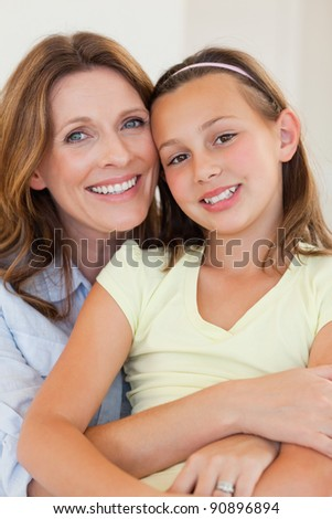 Happy smiling mother and daughter hugging
