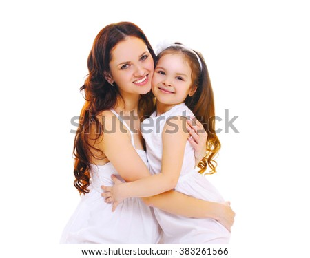 Happy smiling mother hugging little child daughter on a white background - stock photo