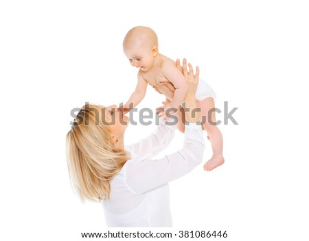 Happy smiling mother playing with baby on a white background