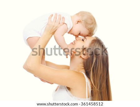 Happy smiling mother with baby having fun together on white background - stock photo