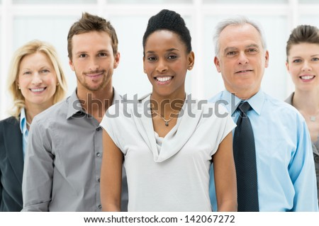 Happy smiling multi ethnic business team in office - stock photo