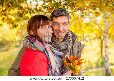 happy smiling outdoor embracing young adults - stock photo