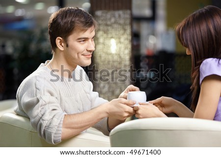 Happy smiling pair of the enamoured have dinner in cafe - stock photo