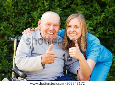 Happy smiling patient showing thumbs up together with his doctor. - stock photo