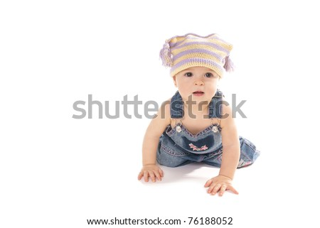 Happy smiling pretty baby girl in fanny head isolated on white background - stock photo
