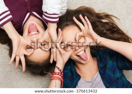 happy smiling pretty teenage girls having fun - stock photo