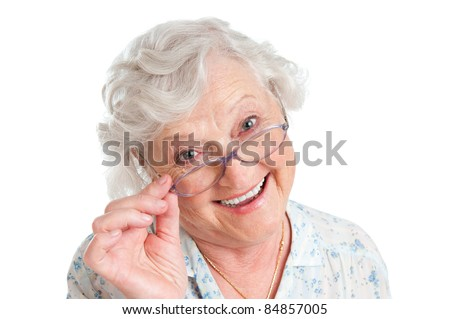 Happy smiling retired lady wearing her new pair of glasses isolated on white background - stock photo
