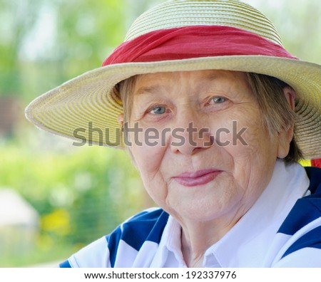 Happy smiling senior woman outdoors in summer  - stock photo