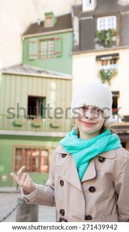 Happy smiling six years old caucasian blond child girl in Paris. Old historic buildings as background. - stock photo