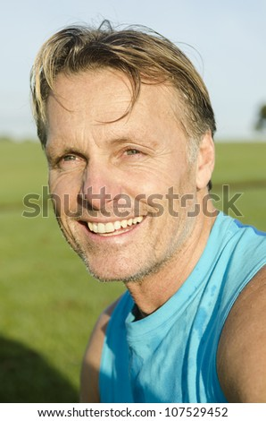 happy smiling sportsman with sweat on his face. - stock photo