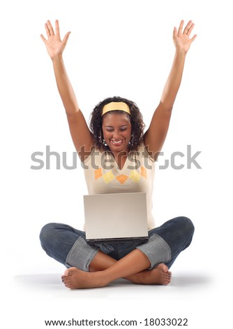 Happy, smiling student online with her laptop - stock photo