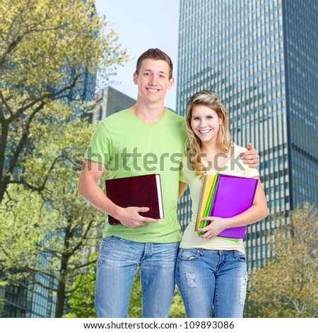 Happy smiling students couple. Education background.