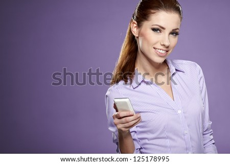 Happy smiling successful businesswoman with cell phone.
