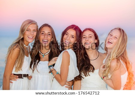 happy smiling summer teens on holiday or vacation - stock photo