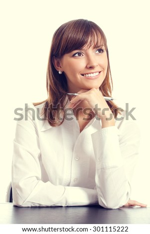 Happy smiling, thinking or planning businesswoman - stock photo