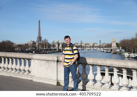 Happy smiling tourist  in Paris, France. - stock photo