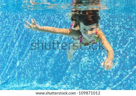 Little girl water park swimming underwater stock photo - Swimming pool girl christmas vacation ...