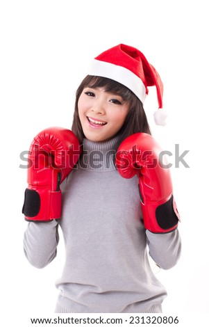 happy, smiling woman wearing christmas santa hat, boxing gloves, xmas and boxing day concept