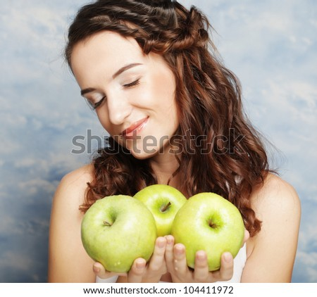 happy smiling woman with three green apple over sky background - stock photo
