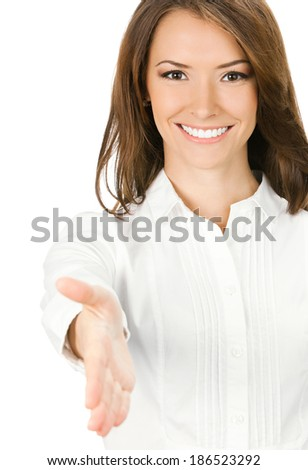 Happy smiling young beautiful business woman giving hand for handshake, isolated over white background - stock photo