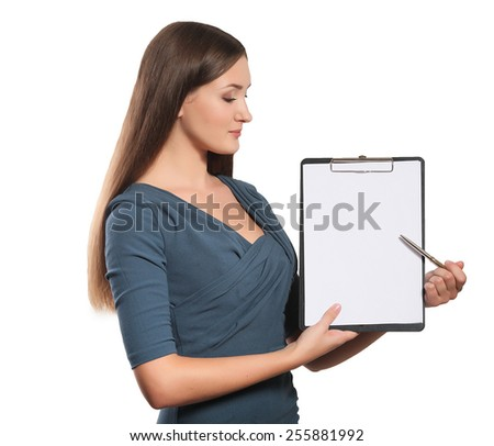Happy smiling young beautiful business woman with clipboard writing, isolated over white background  - stock photo