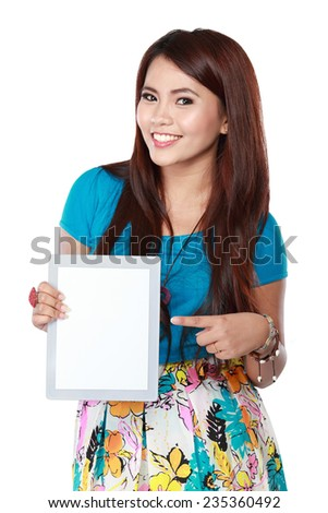 Happy smiling young beautiful woman showing blank tablet, over white background - stock photo