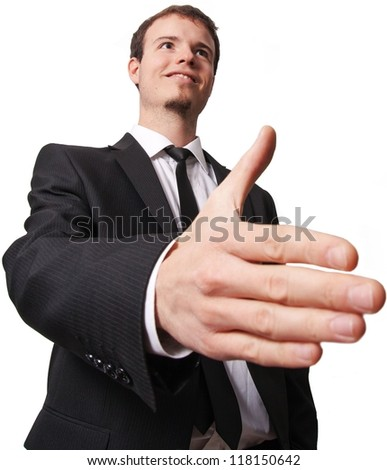 Happy smiling young business man giving hand for handshake, isolated over white background. Focus on face. - stock photo