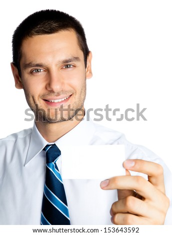Happy smiling young business man showing blank business, plastic, credit card or signboard, isolated over white background - stock photo
