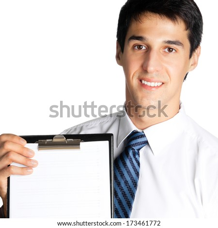 Happy smiling young business man showing blank clipboard, isolated on white background