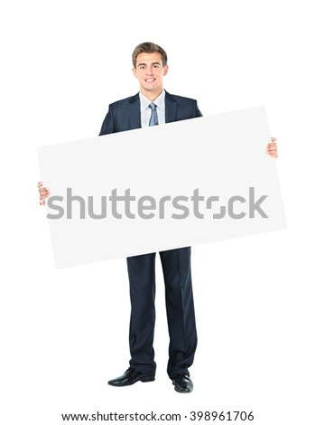 Happy smiling young business man showing blank signboard - stock photo