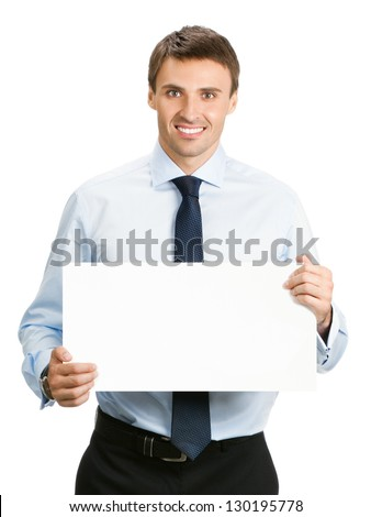 Happy smiling young business man showing blank signboard, isolated over white background