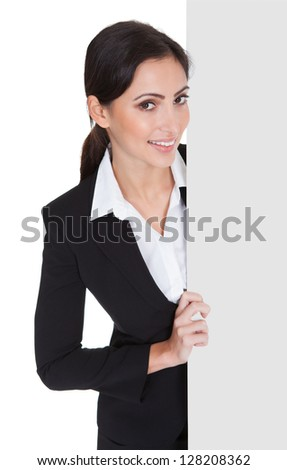 Happy Smiling Young Business Woman Holding Blank Placard. Isolated On White - stock photo