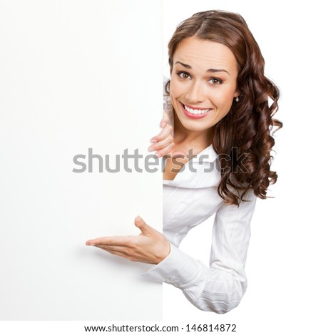 Happy smiling young business woman showing blank signboard, isolated on white background - stock photo