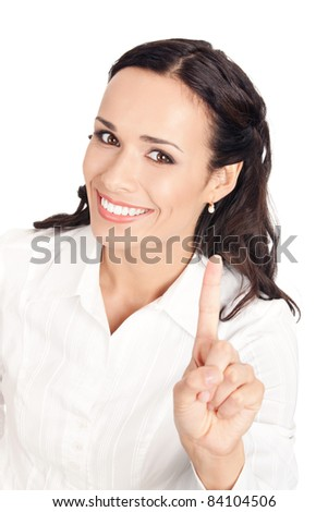 Happy smiling young business woman showing one finger, isolated on white background - stock photo