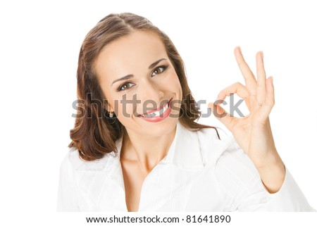 Happy smiling young business woman with okay gesture, isolated on white background
