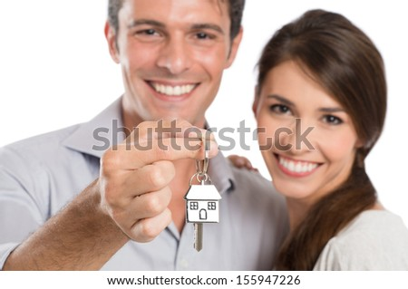 Happy Smiling Young Couple Showing Key Of Their New House Isolated On White Background  - stock photo