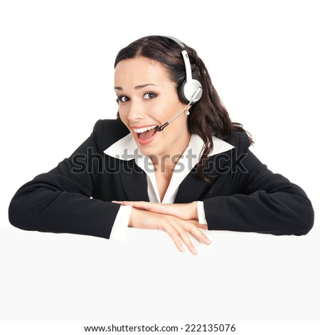 Happy smiling young customer support phone operator in headset showing blank signboard, isolated over white background
