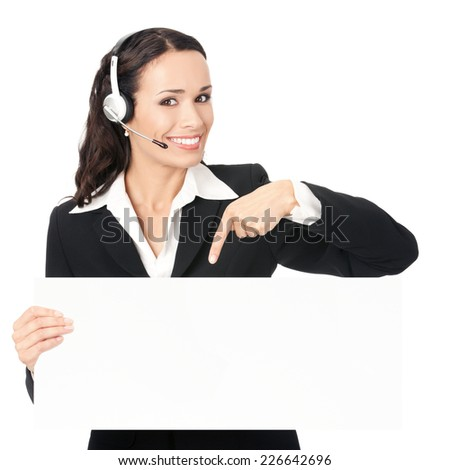 Happy smiling young customer support phone operator in headset showing blank signboard, isolated on white background